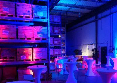 Beleuchtung einer Lagerhalle in Leverkusen für ein Firmenjubiläum